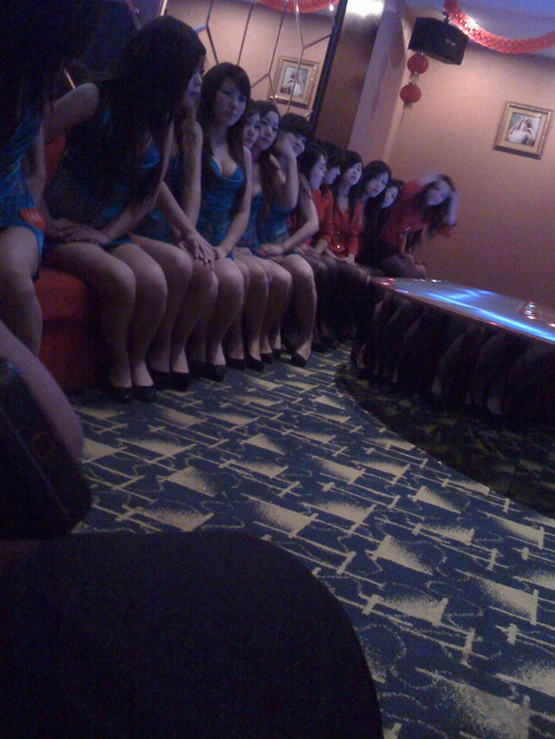 a group of girls sitting in the hall waiting for clients to pick ups